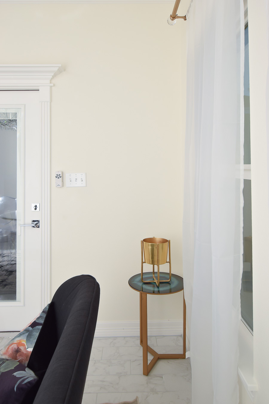 Patio door and bare wall in a small dining room space.