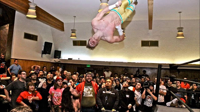 Will Ospreay hits a flip to the outside