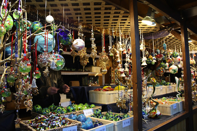 Dangling glass ornaments make guests take pause strolling through Christkindlmarket.