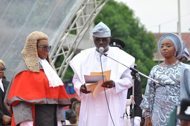 The New Elect Governor Babajide Sanwoolu taking the oath of office as he is sworn in