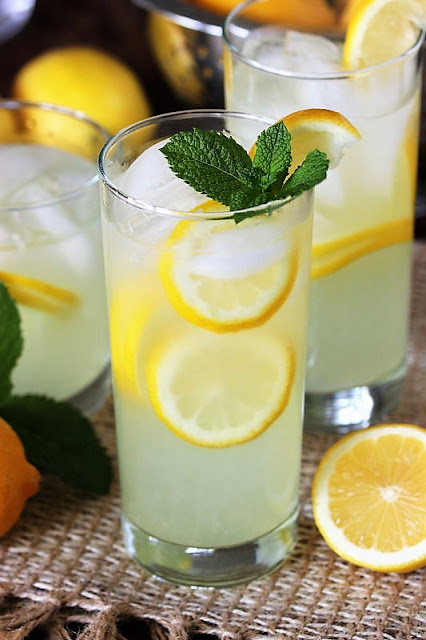 Glass of Homemade Lemonade Garnished with Mint Image