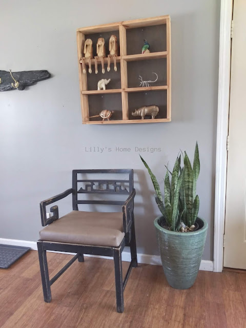 Functional cozy minimalist entryway updates plants vintage furniture display shelf