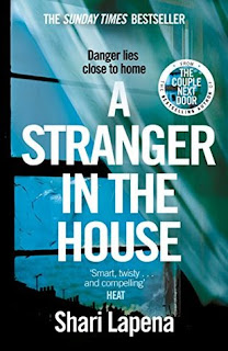 Photo of the book cover of A Stranger in the House by Shari Lapena