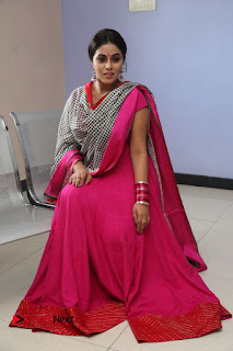 Actress Poorna Pictures in Red Salwar Kameez at Jayammu Nischayammu Raa Teaser Launch  0198.JPG