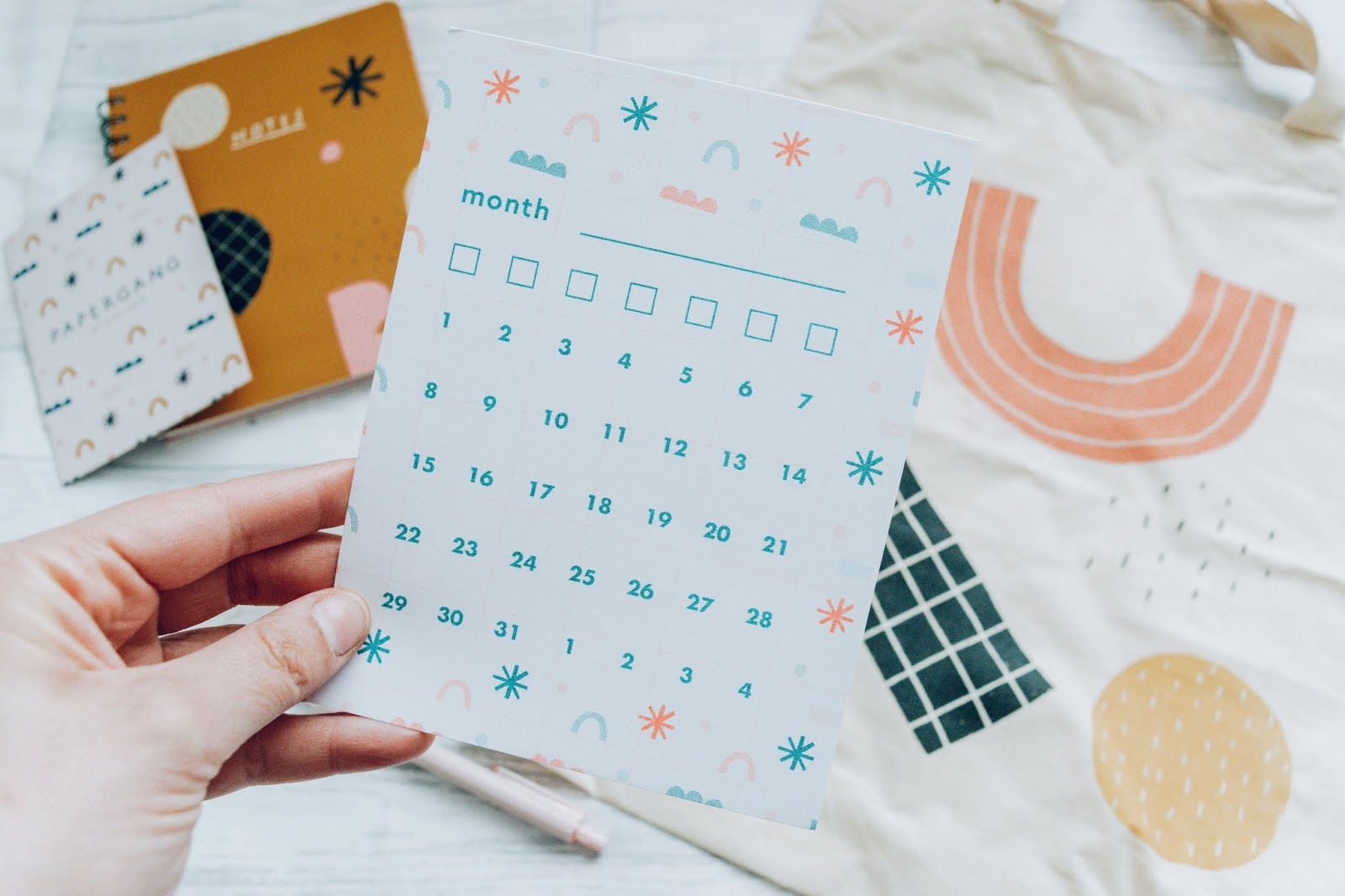 A blank month calendar card with geometric shapes all over