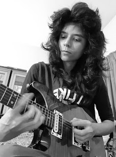 Saima Zakir is a Pakistani musician and female pioneer of electric guitar playing in the country.
