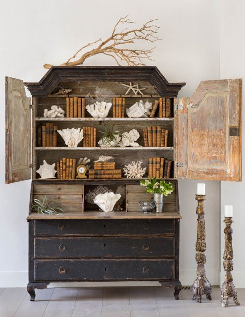 Dark painted Swedish antique secretary desk filled with books and coral - found on Hello Lovely Studio
