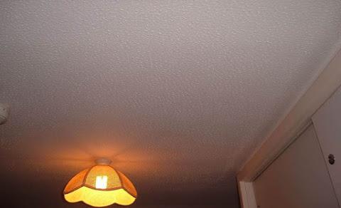 Asbestos textured coating