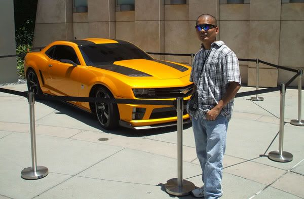 Posing in front of the Chevy Camaro that represents Bumblebee in TRANSFORMERS: DARK OF THE MOON.