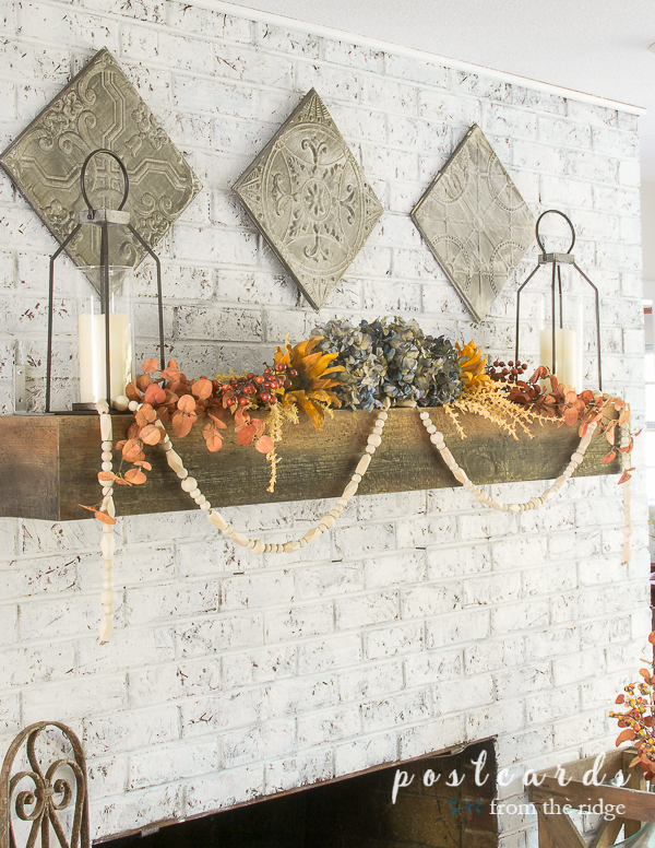 white brick fireplace with muted fall colors