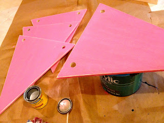 painted scrap wood triangles