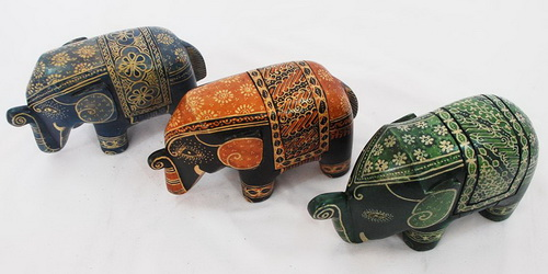 www.Tinuku.com Wooden elephant sculptures appeared in batik art decoupage by Sanggar Peni reviews mystical culture