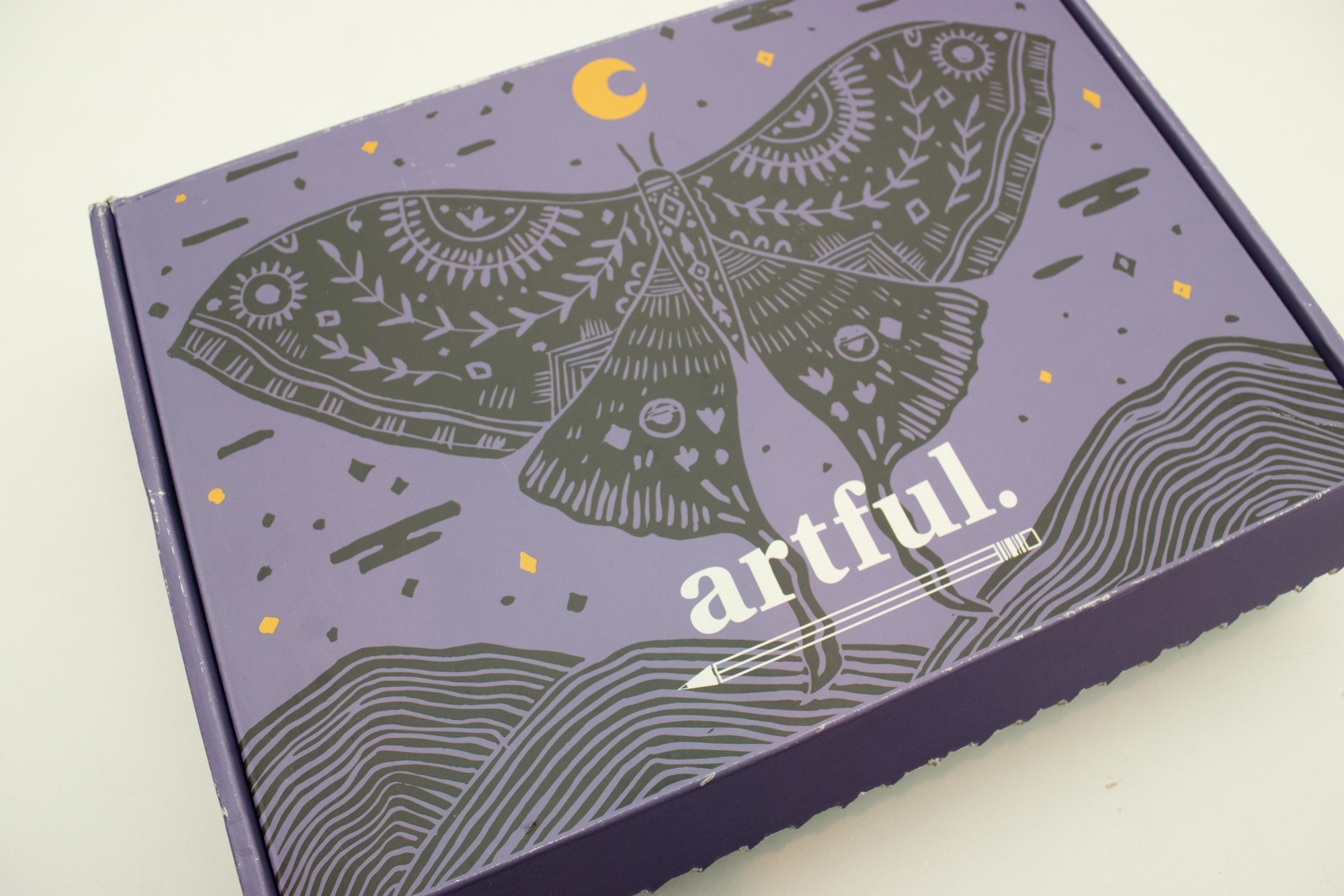 Artful subscription box packaging