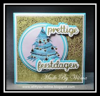 Een gouden en turkoois kerstkaart met een versierde kerstboom. A gold and turquoise Christmas card with a decorated Christmas tree.