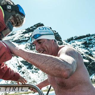 Open water swimmer Lewis Pugh emerging from his Antarctic Ocean swim