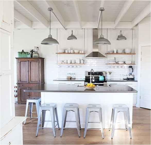 Stunning modern farmhouse kitchen with exposed rafters and vintage armoire found on Hello Lovely