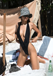 Emily-Ratajkowski-in-a-very-revealing-monokini-while-on-vacation-in-Miami.-c7fcm1v2m0.jpg