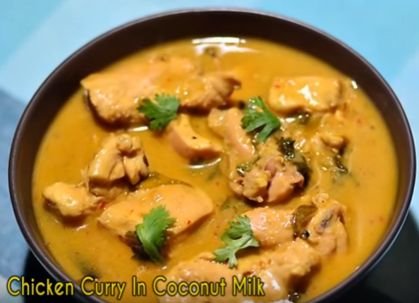 Curried chicken simmered in coconut milk and tomatoes makes for a mouthwatering hint! Goes great with rice and vegetables.