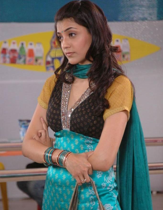 South Indian Hot Actress Kajal Agarwal Sad looking Face In Green Dress