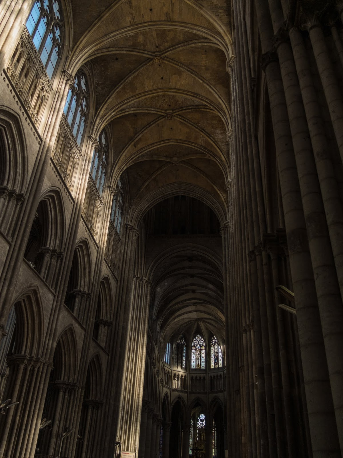 Looking up at the ceiling inside the Cathedral of Rouen.