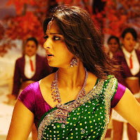 Anushka look spicy in green saree