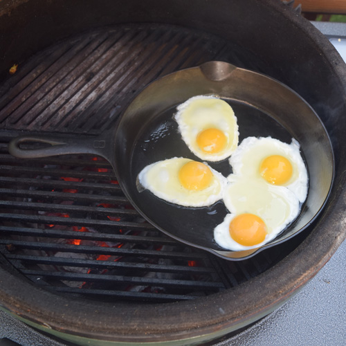 Frying eggs in a Griswold skillet on a big green egg