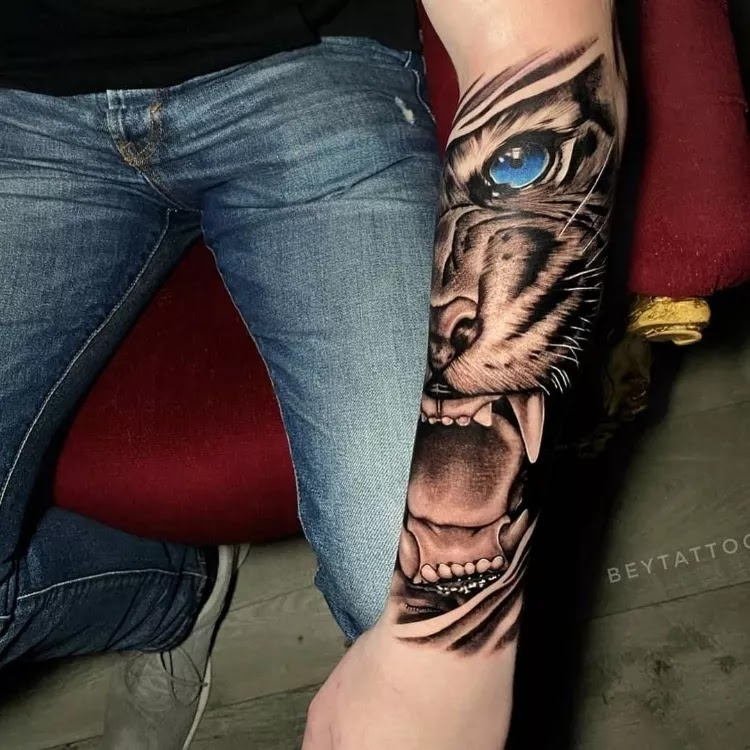 Roaring lion and 3d eyes forearms tattoo