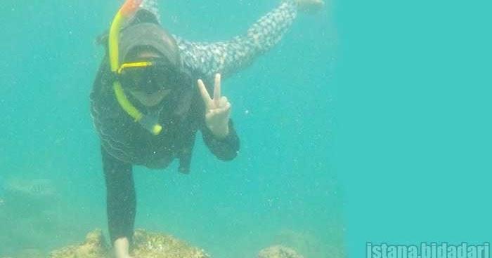pakaian snorkeling bagi wanita berjilbab