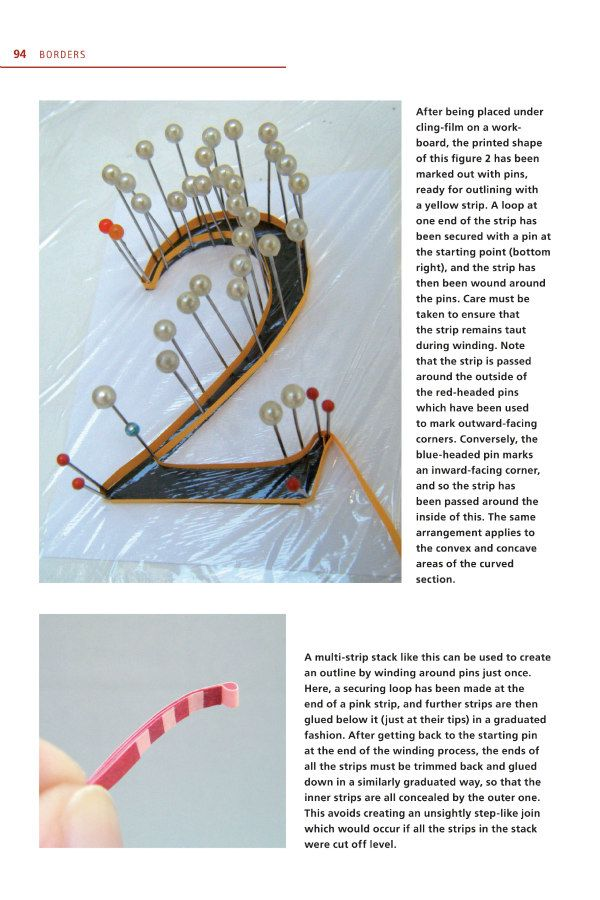 sample quilling book page showing a number outlined with a paper strip held in place with pins