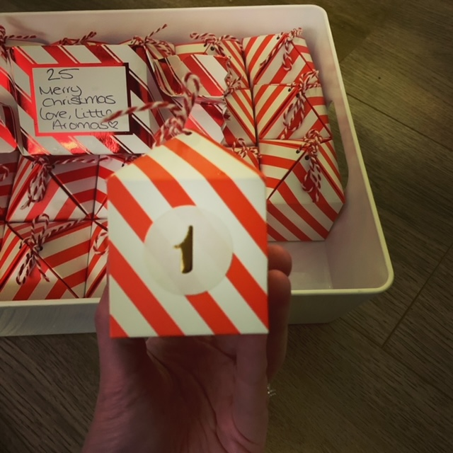 Box number one of an advent calendar, with all the other boxes in the background