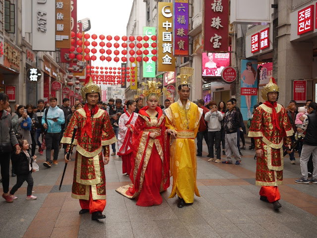 Royalty walking down the Shangxia Jiu Pedestrian Street