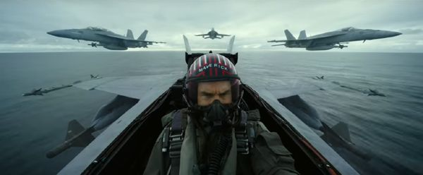 Maverick (Tom Cruise) leads a squadron of F/A-18 Hornets across the ocean in TOP GUN: MAVERICK...which hits theaters nationwide on November 19, 2021.