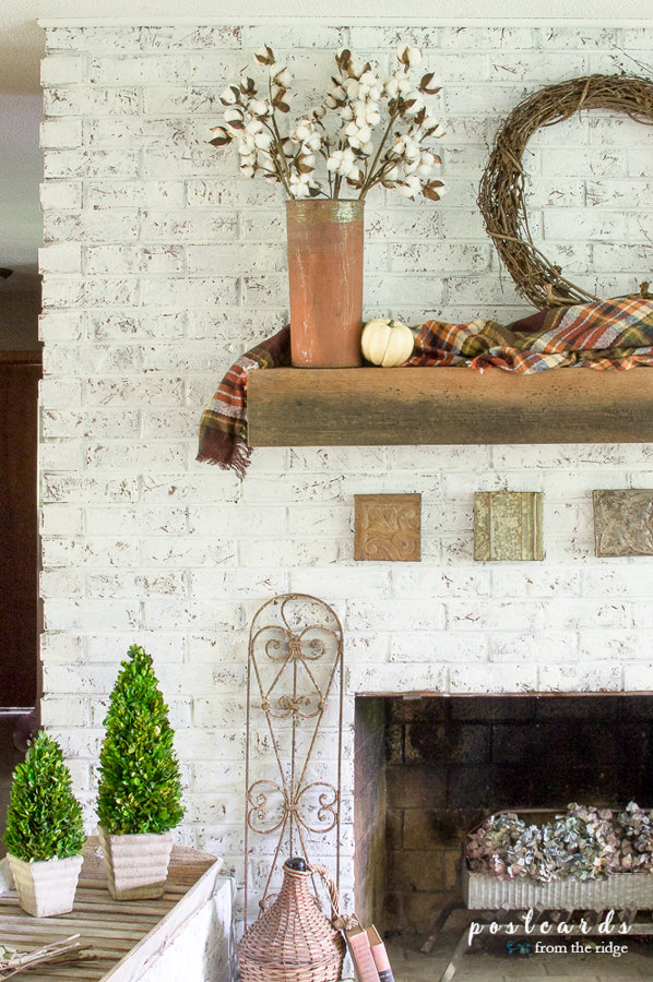 fall mantel with plaid blanket scarf and rustic metal, white painted brick fireplace
