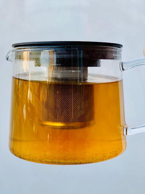 Glass teapot containing tea