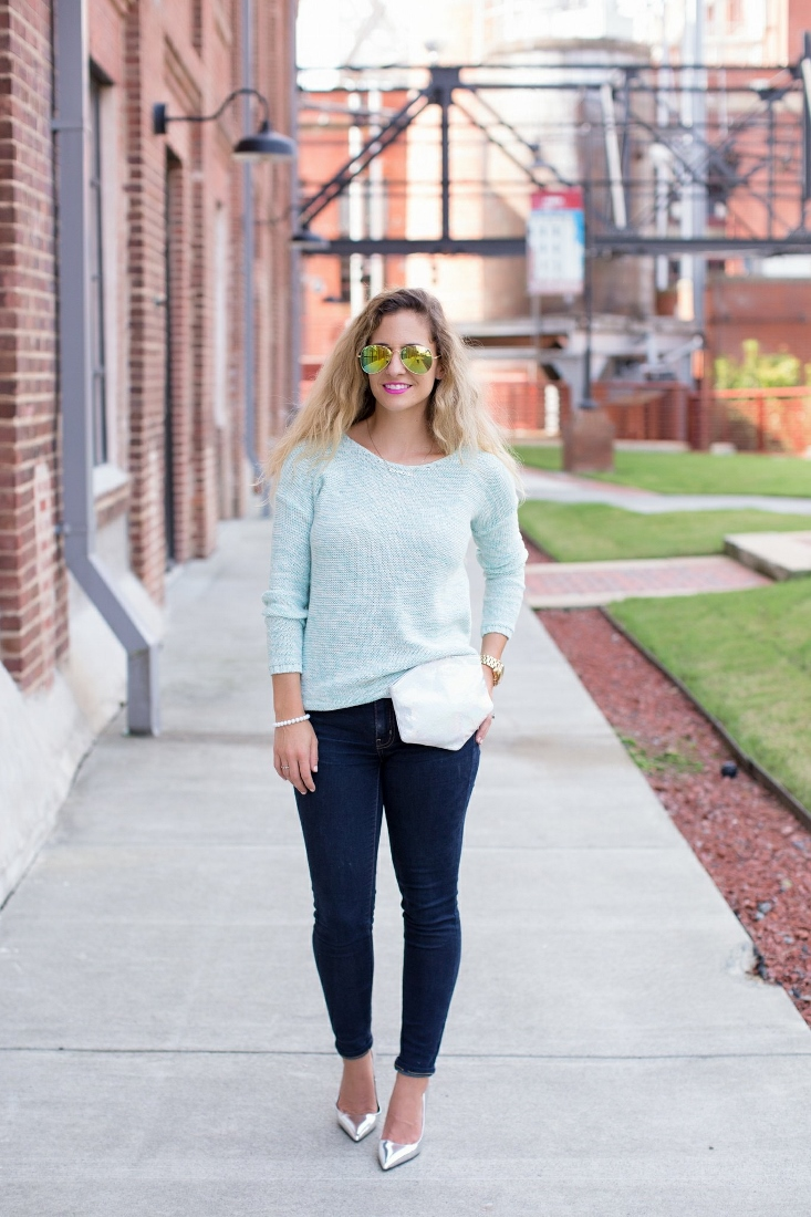 Blue Sweater with Dark Jeans, Silver pointed Pumps, Metallic Belt Bag