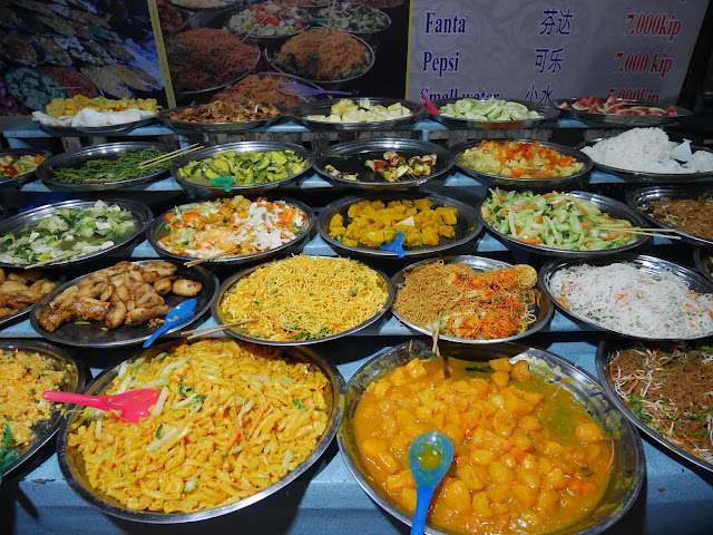 colorful dishes of food at the Luang Prabang night market buffet