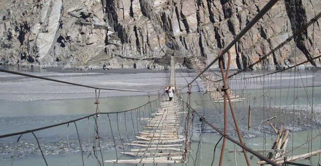 Hussaini Suspension Bridge is built on which river?