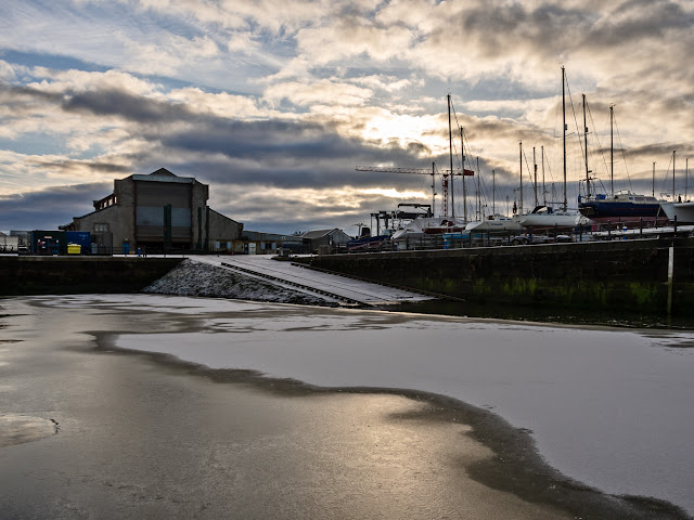 Photo of snow and ice on the water by the marina slipway
