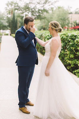 bride and groom first look emotional groom
