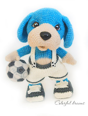 Amigurumi dog with soccer ball and soccer uniform