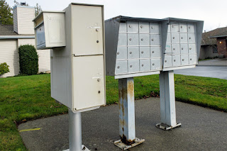 Old Mailboxes Held Together with Zip Ties