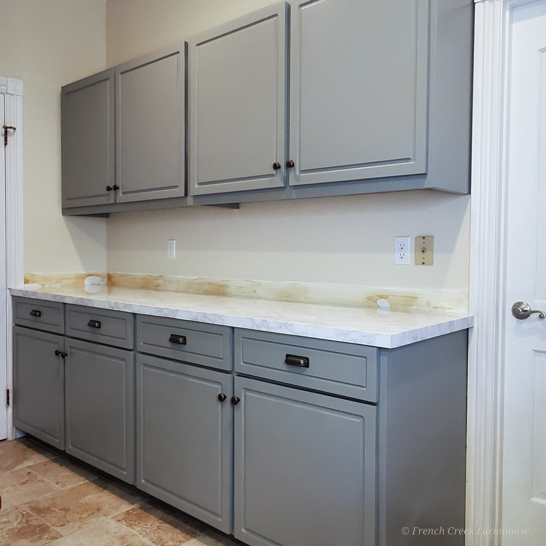 After: Modern gray cabinets with white marble countertops