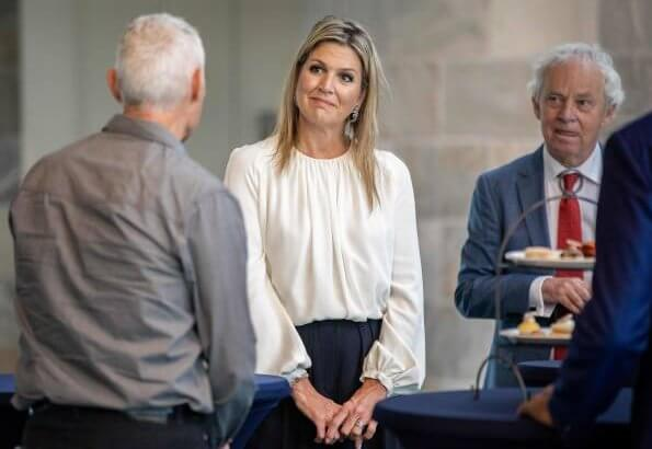 Queen Maxima's outfit is by Belgian fashion house Natan. Queen Maxima wore a silk blouse and wide leg trousers from Natan
