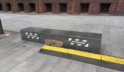 Bench with social distancing warning in Spinningfields, Manchester.