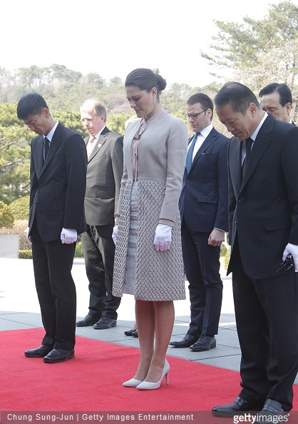 Crown Princess Victoria of Sweden and Prince Daniel of Sweden pay a silent tribute at Seoul National Cemetery during their visit to South Korea