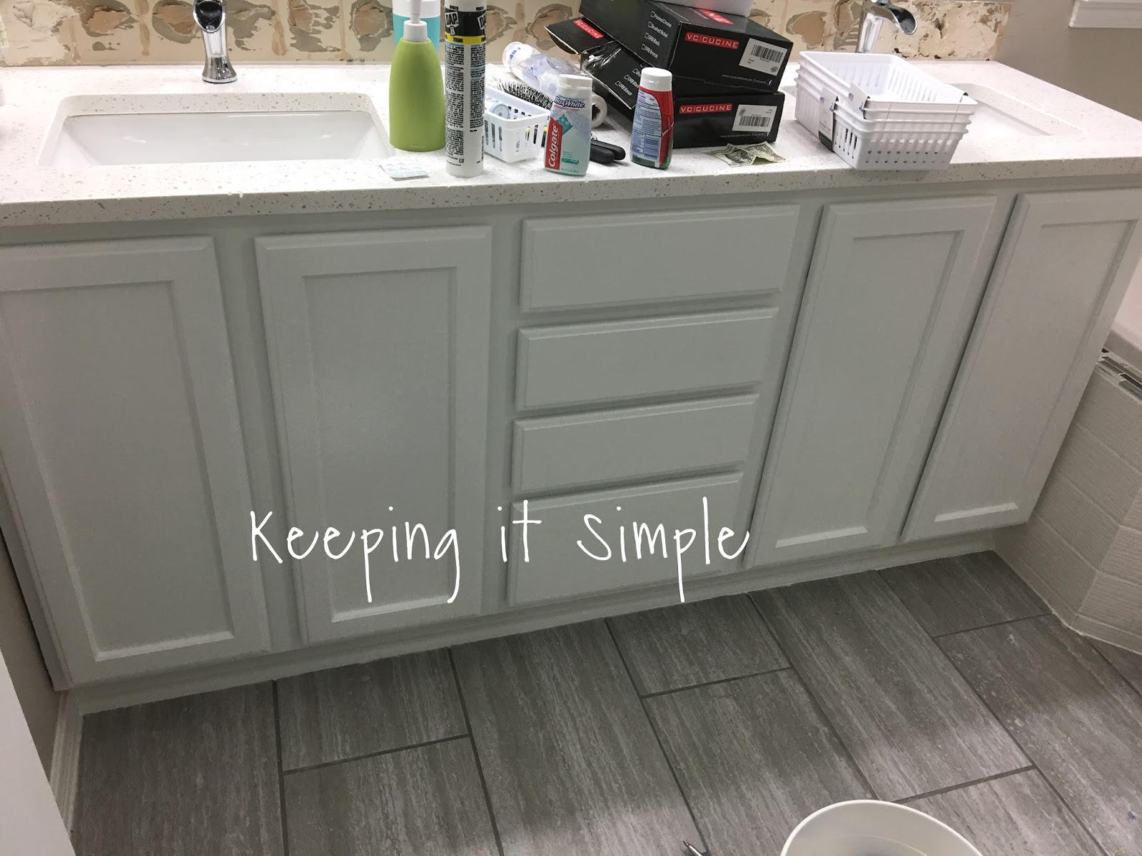 Perfect For the back splash we used the same tiles as on the bathtub To make it go quicker I set out all the tiles before we put them on so when it