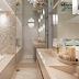 Banheiro com banheira sofisticado neutro com metais dourados e mosaico de ônix!
