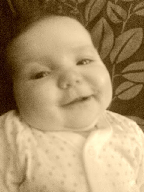 Baby girl sepia photo smile