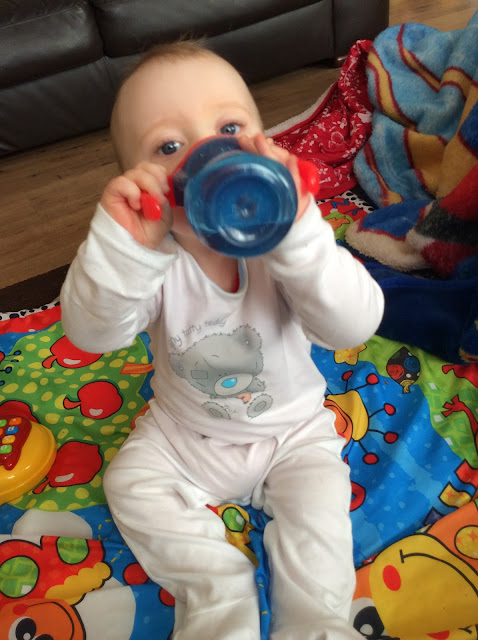 Baby Drinking Out Of A Sippy Cup