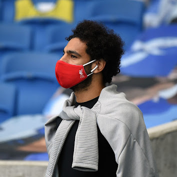 Salah wearing the Liverpool FC mask